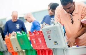 Man sorting through First Aid and Trauma Kits